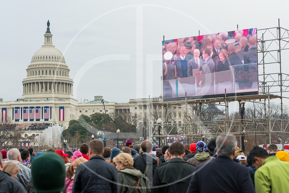Washington DC, United States - Former Presidents, First Ladies and dignitaries are seen on a Jumbotron during the 2107 inauguration of Donald J. Trump.