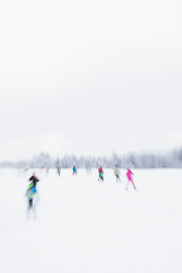 Blurred picture of people skiing on snow