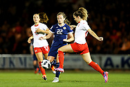 Alisha Lehmann (#23) of Switzerland clears the ball under pressure from Erin Cuthbert (#22) of Scotland during the 2019 FIFA Women's World Cup UEFA Qualifier match between Scotland Women and Switzerland at the Simple Digital Arena, St Mirren, Scotland on 30 August 2018.