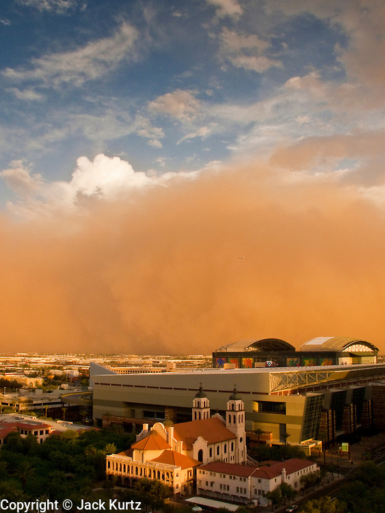 """18 JULY 2009 -- PHOENIX, AZ: A """"haboob"""" blows into downtown Phoenix Saturday night. A haboob is a type of intense sandstorm commonly observed in the Sahara desert (typically Sudan), as well as across the Arabian Peninsula, throughout Kuwait, and in the most arid regions of Iraq. The word haboob comes from the Arabic word for """"Strong Wind.""""  PHOTO BY JACK KURTZ"""