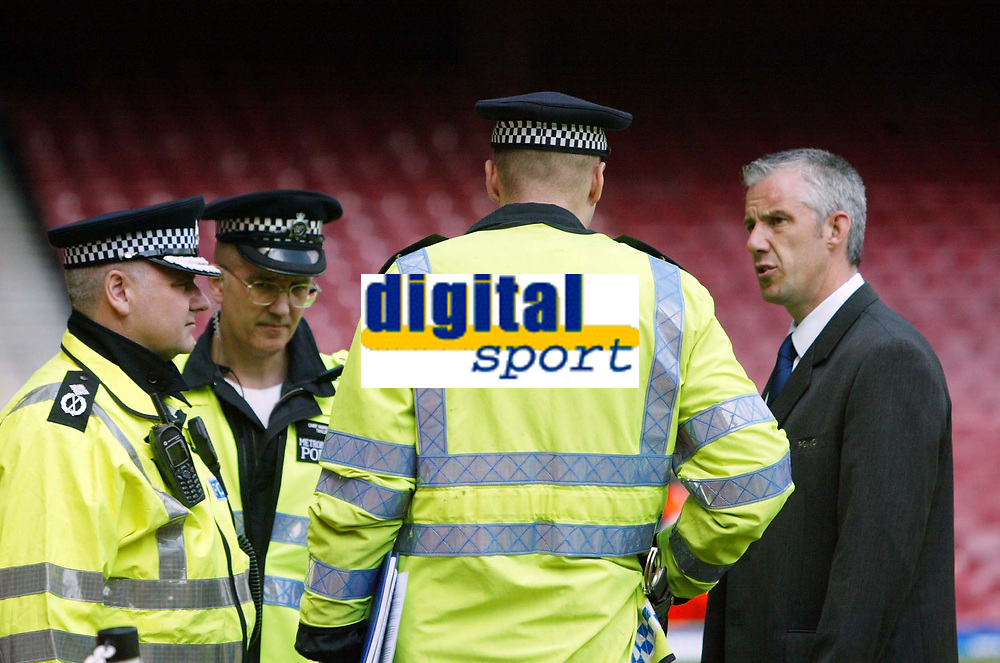 Photo: Chris Ratcliffe.<br /> West Ham United v Tottenham Hotspur. The Barclays Premiership. 07/05/2006.<br /> Chris Foy, the referee (far right) chats to police before the game is decided to be on.