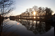 The sun setting over a lake in Uckermarkische Seen Natural park, part of the The Feldberg Lake District Nature Park containing large lakes, kettle bogs, and an abundance of plant and animcal species. Brandenburg, Germany. (Photo by Phil Clarke Hill/In Pictures via Getty Images).