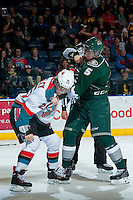 KELOWNA, CANADA - JANUARY 22: Colton Heffley #25 of the Kelowna Rockets drops the gloves with Ben Betker #5 of the Everett Silvertips during the second period on January 22, 2014 at Prospera Place in Kelowna, British Columbia, Canada.   (Photo by Marissa Baecker/Getty Images)  *** Local Caption *** Colton Heffley; Ben Betker;