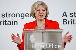 © Licensed to London News Pictures. 23/03/2015. LONDON, UK. Home Secretary Theresa May delivering a speech on tackling extremism at RICS in central London on Monday 23 March 2015. Photo credit : Tolga Akmen/LNP