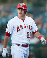 The Angels' Mike trout walks back to the dugout after striking out during the Halos' victory over the Houston Astros 2-1 in 13 innings Wednesday at Angel Stadium.