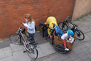 A young child climbs out of a Babboe Cargo Bike in south London, on 9th September 2020, in London, England.