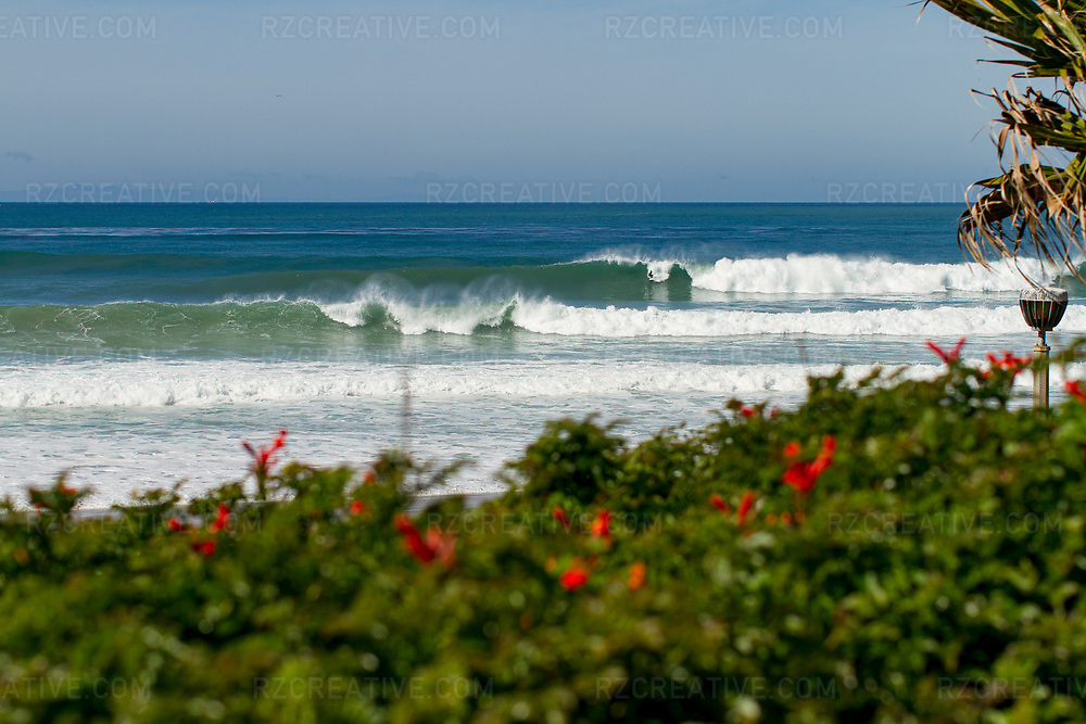 A surfer drops into a large wave at Salt Creek in Dana Point, Calif. Photo © Robert Zaleski / rzcreative.com<br /> —<br /> To license this image contact: robert@rzcreative.com