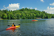 Two kayakers kayaking on Raven Lake<br />Dorset<br />Ontario<br />Canada