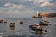 Fishing boats in harbor at dawn, Havana, Cuba