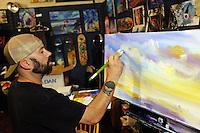 Artist David Marple at work on a painting at The Bowl Creative Gallery & Studio at 319 Main St. in Salinas.