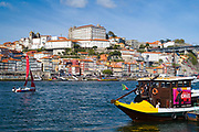 Rabelo boat - port wine barge - a tourist attraction at V|la Nova de Gaia in Porto, Portugal