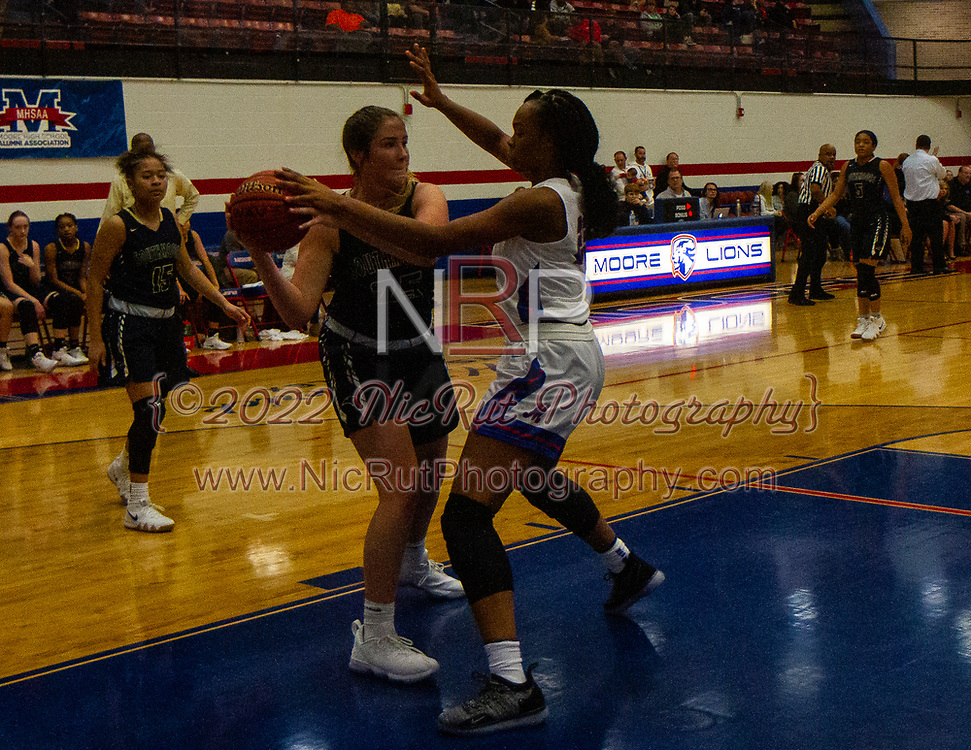 Southmoore's Morgan Ashton looking for an open teammate as the Lions make shooting difficult for the Sabercats during their game on Tuesday, December 18, 2018 at Moore High School.