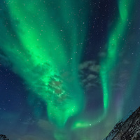 We waited in the cold and dark under a sky full of stars on a beautiful deserted beach.  Then, a faint green glow indicated to us that we were in for a cosmic treat.  My very first experience viewing the aurora borealis took my breath away and left me utterly spellbound.