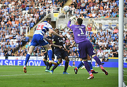 Derby County goalkeeper Scott Carson makes a save from Reading's Jon Dadi Bodvarsson (left)