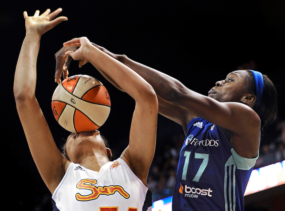 New York Liberty's Essence Carson, right, fouls Connecticut Sun's Chay Shegog during the second half of a WNBA basketball game in Uncasville, Conn. (AP Photo/Jessica Hill)