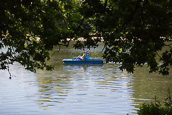 People enjoy the hot sunshine on the boating lake in Regents Park, London, as the heatwave continues to grip the capital. London, June 29 2018.