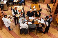 Overview, Men eating lunch, Al-Quds Restaurant, Downtown Amman, Jordan.