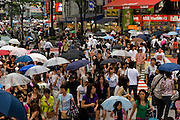 People walk on a busy street in Shibuya District, Tokyo, Japan.
