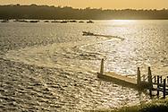 Boat pulling away from Dock, Coecles Harbor, , Shelter Island, NY