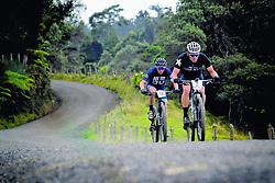 """November 2, 2018 - (03/11/2018) Lance Armstrong (3) busca el puesto de control en La Central, en las faldas del volcán Turrialba, junto a su coequipero Mike Kloser. Armstrong entró de 22, en la segunda etapa entre Tres Ríos y Turrialba. PROHIBIDO EL USO O REPRODUCCIÃ""""N EN COSTA RICA. (Credit Image: © John Duran/La Nacion via ZUMA Press)"""