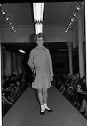 09/03/1964<br /> 03/09/1964<br /> 09 March 1964<br /> McBirney's Fashion show at McBirney's, Aston Quay, Dublin. Image shows Barbara wering a green suit.
