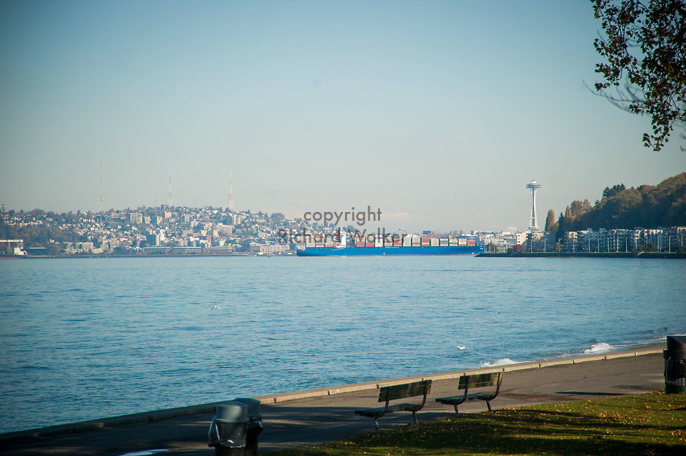 2017 NOVEMBER 06 - A container ship and Space Needle seen from Alki Beach, Seattle, WA, USA. By Richard Walker