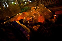 A homeless man sleeps under highway in Kamagasaki, Japan.