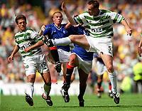 Barry Ferguson and Billy Dodds(Rangers) Joos Valgaeren and Stilian Petrov (Celtic). Celtic 6:2 Rangers, Scottish Premier League, Celtic Park, Glasgow, Scotland, 27/8/2000. Credit Colorsport: Stuart MacFarlane.