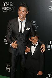 LONDON, Oct. 23, 2017  Cristiano Ronaldo arrives with his son Cristiano Ronaldo Jr. for the The Best FIFA Football Awards 2017 at the London Palladium, in London, Britain on Oct. 23, 2017. (Credit Image: © Tim Ireland/Xinhua via ZUMA Wire)