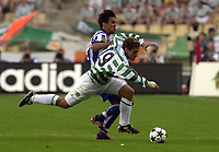 Photo: Greig Cowie<br /> Celtic v Porto. UEFA Cup Final. Seville. 21/05/2003<br /> Stilian Petrov takes a tumble under challenge from Paulo Ferreira