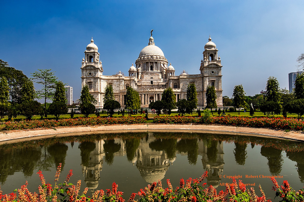 Monumental Pond: Victoria Monument stands reflected within the pond that is held within the flowering gardens, Kolkata (Calcutta) India.