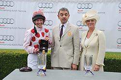 Left to right, PHILIPPA HOLLAND, ROWAN ATKINSON and the COUNTESS OF MARCH at the 3rd day of the 2012 Glorious Goodwood racing festival at Goodwood Racecourse, West Sussex on 2nd August 2012.
