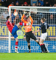 Laffrety goes in on keeper Michael McGovern..Falkirk 3 v 2 Rangers..©Pic : Michael Schofield.