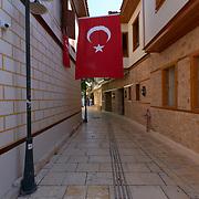 Big Turkey flag in Kaleici district narrow street in Antalya old town