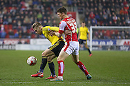 Middlesbrough midfielder Adam Clayton (8)  shields the ball from Rotherham United midfielder Richard Smallwood (33)  during the Sky Bet Championship match between Rotherham United and Middlesbrough at the New York Stadium, Rotherham, England on 8 March 2016. Photo by Simon Davies.