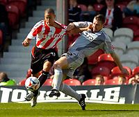 Photo: Alan Crowhurst.<br />Brentford v Bradford City. Coca Cola League 1. 08/04/2006. Brentford's Alex Rhodes (L) with Darren Holloway.