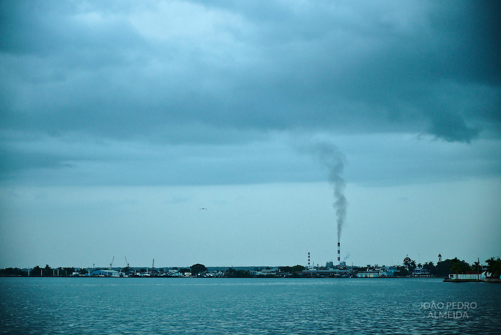 The calm waters of Cienfuegos Bay with the industrial area in the background