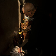 Brother Remy, monk in charge of the sacristy, prepares the material for the Mass. Solesmes on 18-10-19<br /> Le frère Rémy, moine en charge de la sacristie prépare le matériel pour la messe. Solesmes le 18-10-19