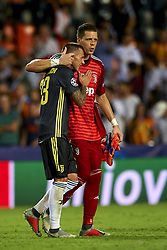 September 19, 2018 - Valencia, Spain - Emre Can, Wojciech Szczesny  (R) celebrates victory after the Group H match of the UEFA Champions League between Valencia CF and Juventus at Mestalla Stadium on September 19, 2018 in Valencia, Spain. (Credit Image: © Jose Breton/NurPhoto/ZUMA Press)