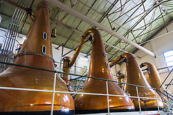 Stills inside still room Room at Lagavulin Distillery on island of Islay in Inner Hebrides of Scotland, UK