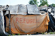 Calais August 2015 The Jungle, camp of migrants, most of whom are trying to get to England. A make-shift shack with the word refugee written on it.