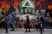 London, UK. Friday 5th September 2012. 'Freedom for Humanity' a street art graffiti work by artist Mear One aka Kalen Ockerman on Hanbury Street near Brick Lane. Tower Hamlets has ordered that the mural be removed as the characters depicted as bankers have faces that look Jewish, and is therefore antisemitic. In protest the mural had just been sprayed with the Hebrew word 'HAGANAH'. Haganah was a Jewish paramilitary organization in what was then the British Mandate of Palestine from 1920 to 1948, which later became the core of the Israel Defense Forces.