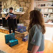 Erin celebrates the first night of Chanukah with her children at home. After dinner, Brooklyn and Spencer try to guess their gifts before opening them.
