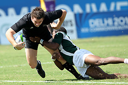 Kurt Baker goes over for a try during the XIX Commonwealth Games 7s rugby match between New Zealand and Guyana held at The Delhi University in New Delhi, India on the  11 October 2010..Photo by:  Ron Gaunt/photosport.co.nz