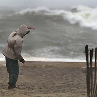 (PPAGE1)  Sea Bright 10/16/2002 L-R Bill Burns and friend Eric Tronco both of Middletown brave the rain, wind on blowing sand to see the waves on the public beach in Sea Bright  Michael J. Treola Staff Photographer........MJT