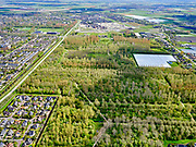 Nederland, Noord-Holland, Heerhugowaard, 07-05-2021; Het Kruis. Rustenburgerweg, Oosttangent, zicht op bos Waarderhout en Schilderswijk.<br /> <br /> luchtfoto (toeslag op standard tarieven);<br /> aerial photo (additional fee required)<br /> copyright © 2021 foto/photo Siebe Swart