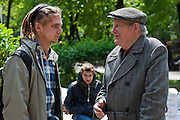 Moscow, Russia, 15/05/2012..A visiting pensioner talks to a protester in Chistiye Prudy, or Clean Ponds, as a Moscow court ordered the eviction of some 200 opposition activists who have set up camp in the city centre park.