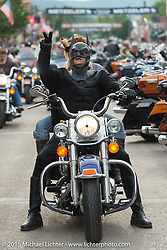 Batman rides through Main Street during the 75th Annual Sturgis Black Hills Motorcycle Rally.  SD, USA.  August 7, 2015.  Photography ©2015 Michael Lichter.