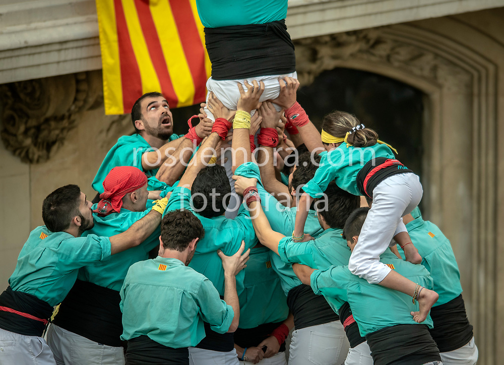 """Members of Castellers de Vilafranca celebrate having finished without falling the human tower """"1 of 9 fm"""", of extreme difficulty in the last performance of the season in Vilafranca del Penedès,Barcelona, Spain. 1st Nov 2019."""
