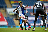 Lewis Travis of Blackburn Rovers is tackled by Madger Gomes of Doncaster Rovers  during the EFL Cup match between Blackburn Rovers and Doncaster Rovers at Ewood Park, Blackburn, England on 29 August 2020.